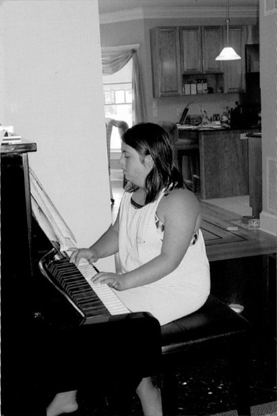 Melissa playing piano