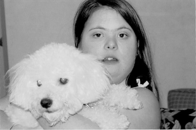 Picture of Melissa holding her dog