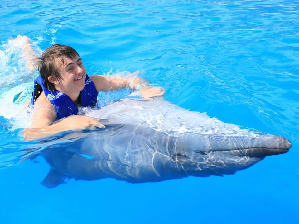 Sean swimming with dolphin