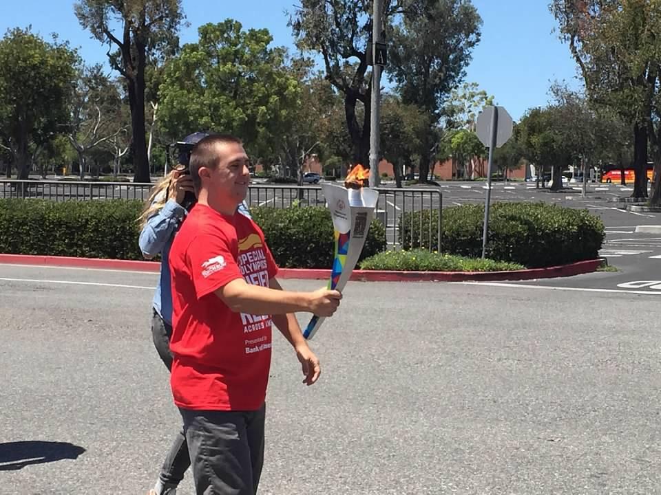 Sean carrying a tourch